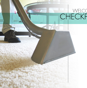 Checkpoint Technician Cleaning A Carpet